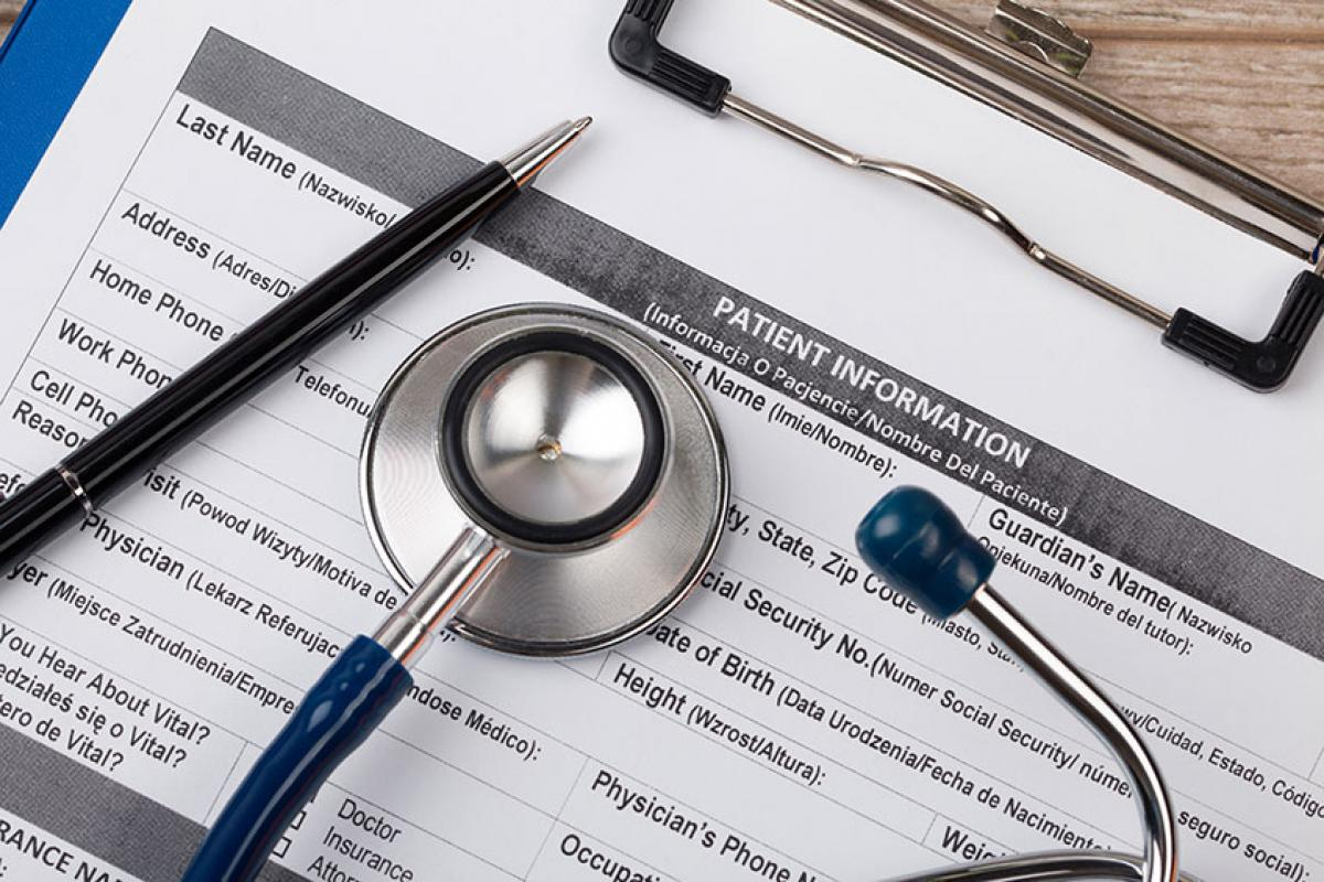 stock photo of a clipboard with a medical form on it and a stethoscope